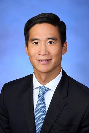 Mr Douglas C. K. Woo, JP